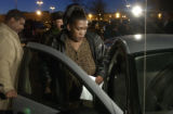 (FOREGROUND TO BACKGROUND) Shely Lowe (CQ), of Aurora, is helped into her car by boyfriend Aaron...