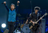 Mick Jagger, left, and Keith Richards, right, lead the rest of the Rolling Stones during a sold...