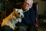 David Dodge (cq), 85, sits at his Aurora home on December 9, 2005 with his dog, Princess, who was...