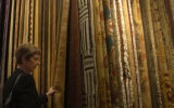 K.K. Ciruli(cq), looks at rugs in the new Ashley Campbell home furnishing store which opened in...