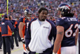 Denver Bronco tight end Dwane Carswell, left, talks with teammate Chris Myers, right, was Carswell...
