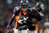 JPM1089 -- Denver Broncos cornerback  Champ Bailey, left, celebrates his eighth interception of...
