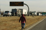 Carlos Torres (cq), from St. Louis Mo., walks along the intersection of I-70 and E-470 Monday...