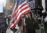 (Denver, Colorado, 11/29/2005) A woman carrying an American flag from Morrison who did not want to...
