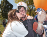 Boise State University sorority member Jessica Johnson gives a kiss to a cardboard cutout of...