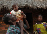 (NYT2) MWAKIKOME, Malawi -- Nov. 26, 2005 -- AFRICA-CHILD-BRIDES-2 -- When she was only 14,...