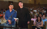 (DENVER, Colo., April 15, 2004) Vy Nguyen, left in blue shirt, and Robert Shuman, right in black...
