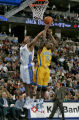 Nuggets guard Andre Miller steals a rebound by New Orleans/Oklahoma City Hornet player Speedy...