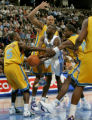 Nuggets guard Earl Boykins is mobbed by a swarm of  New Orleans/Oklahoma City Hornets in the...