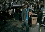 Nuggets forward Carmelo Anthony, makes his way into the Pepsi Center before the Nuggets took on...