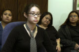 (LEFT to RIGHT), Miranda Macias, 20, (cq), Fona Gilley, 18, (cq), foreground with tie and glasses,...