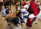 Children hug  Santa good bye at the Denver Rescue Mission's 18th Annual Children's Christmas Party...
