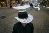 Snow starts to cover the brim of the cowboy hat of Reed McConville (cq), 23, of Gypsum as he tries...