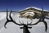 A view of Two Elk Lodge and part of China Bowl looking through the antlers of an elk statue that...