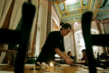 Boulder Dushanbe Teahouse bartender and buser Peter Trench (cq) of Louisville sets a table as the...