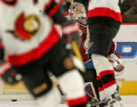 Colorado Avalanche goalie Vitaly Kolesnik looks up at the score board after the Ottawa Senators'...
