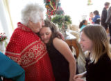 Park Place resident Lou Knous, cq, left, says goodbye to Steele Elementary School students Paige...