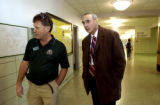 (AURORA., Colo., Nov. 28, 2005)  Aurora's new police chief Daniel Oates walks with principal Dean...