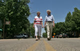 Friends Betty Willis (cq), 76 years old and Elsie Fisher (cq), 78 years old, left to right, walk...