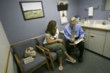 (Lt. to Rt.) Joan Harrison (CQ), of Broomfield, visits with Dr. David Ehrenberger (CQ) Vice...