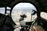 A look out the nose a Boeing B-17, Thursday June 8, 2006 as it flies over the Colorado front...