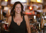 KAS007 Lisa Nieto (cq) works as a bartender at Rialto Restaurant on the 16th Street Mall on...