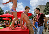 Cetily Stephenson (cq), 26, left, a dancer with Avelon Entertainment, and PrideFest goers Jason...