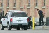 Denver Police drag an unidentifed member of (S.W.AT or Denver Police Deparment officer) out of the...