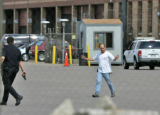 One of over 30 Safeway warehouse workers escapes through the north side docks of the Safeway...