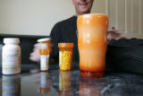 Kirk Derichsweiler gets ready to take the multitude of pills after his kidney transplant.  His...