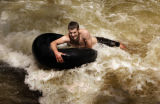 Jon Braun (cq), 20, a Student at the University of Colorado struggles to stay afloat as he takes...