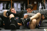 Rockies'Third-baseman Garrett Atkins (left) and  First-baseman Todd Helton (cq) relax in the...