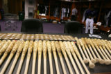 Three dozens signed wood baseball bats and 72 baseballs are spread out on a table in the Rockies...