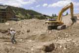 KAS088 Construction workers with Milender White Construction move earth at the site of two new...