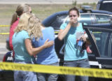 Unidentified women who were said to be witnesses to the accident, are comforted and taken away to...