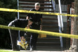 Westminster Police Officers Chris Pardo (cq) and  Rich Ledger (cq) investigate a homicide scene at...