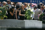 Family and friends gather at St. James Episcopal Cemetery in Marietta, GA  on June 29, 2006, after...