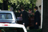 Pallbearers carry Patsy Ramsey's casket after services out of Roswell United Methodist Church to...
