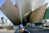 Patrick O'Connell (cq) makes his way past construction of the new wing of the Denver Art Museum on...