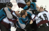 (San Jose, Ca., April 22, 2004)  Colorado Avalanche's #38, Matthew Barnaby, right, is punched by...