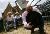 Craig Trudeau, 17, of Cahone, bows his head in prayer before the bull-riding competition on the...