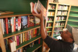 Robert Aikens, CQ,  owner of Verbatim Booksellers in Vail, packs books for a move across the...