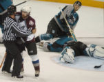 (San Jose, Calif., April 24, 2004)  Colorado Avalanche's #21, Peter Forsberg being held back by a...