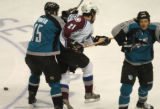 (San Jose, Calif., April 24, 2004)  Colorado Avalanche's #21, Peter Forsberg, center, is knocked...