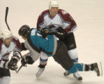 (San Jose, Ca., April 22, 2004)  Colorado Avalanche's #4, Rob Blake, right, takes down San Jose...