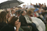 Coni Sanders, daughter of slain teacher Dave Sanders, listens to Dawn Anna speak at the...