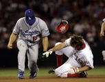 Los Angeles Angels of Anaheim vs. the Los Angeles Dodgers --Angels Jeff DaVanon gets hit in the...