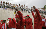 Athletes from Ontario cheer as they enter the stadium for the parade of athletes during the  the...