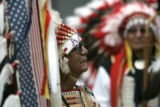 Austin Box (cq) with the southern Ute Tribe in Colorado holds a veteran staff during the opening...