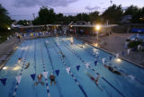 KAS550 Swimmers continue doing laps as the sun sets on the first day of 24-4-Molly at Skyline...